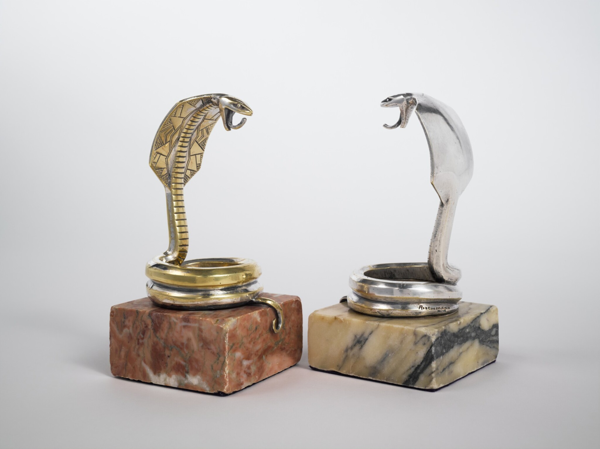 """View full screen - View 1 of Lot 55. Two """"Cobra Royal"""" Pocket Watch Holders."""