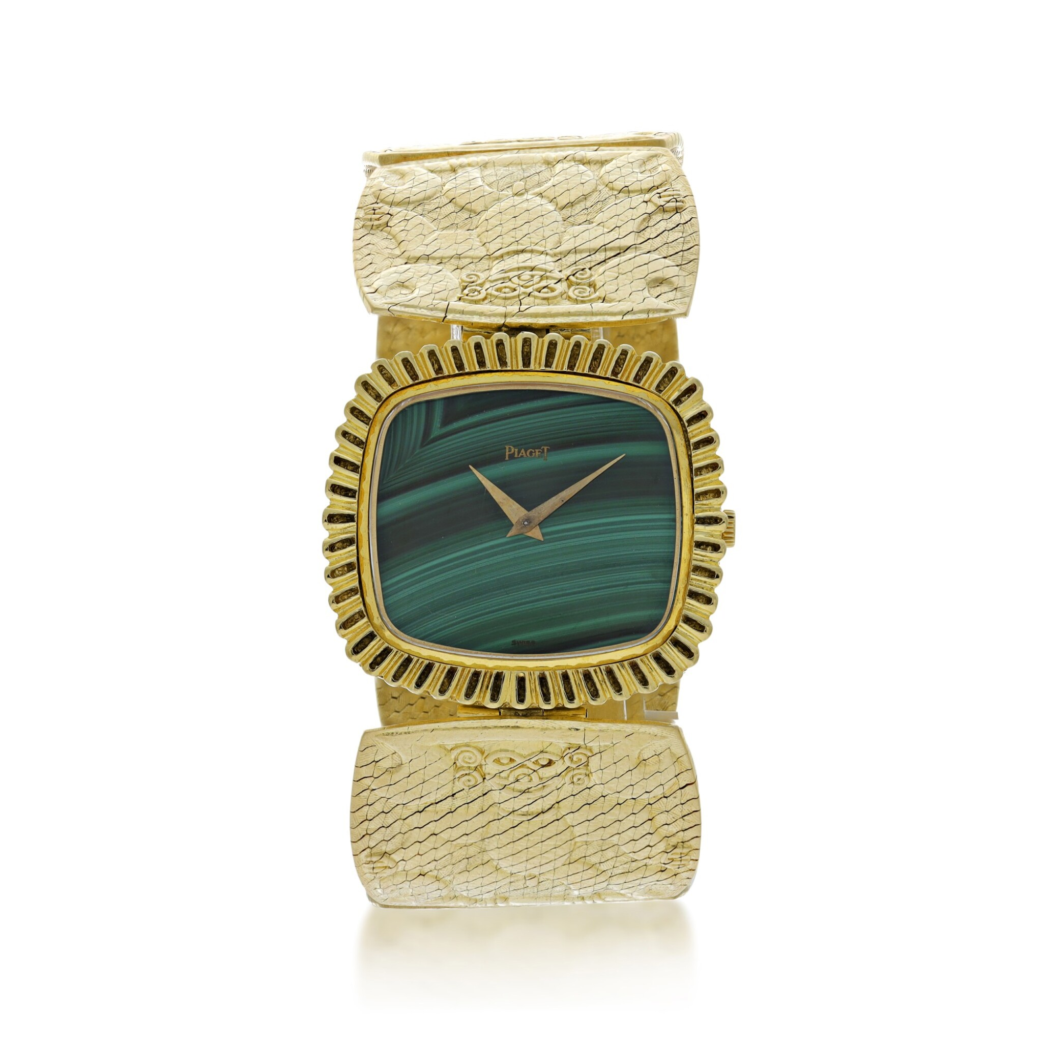 View full screen - View 1 of Lot 66. PIAGET | REFERENCE 9431 B72 A YELLOW GOLD CUSHION SHAPED BRACELET WATCH WITH MALACHITE DIAL, CIRCA 1971.
