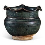 A rare black-glazed foliate-rimmed jar, Northern Song / Jin dynasty   北宋 / 金 黑釉花口罐