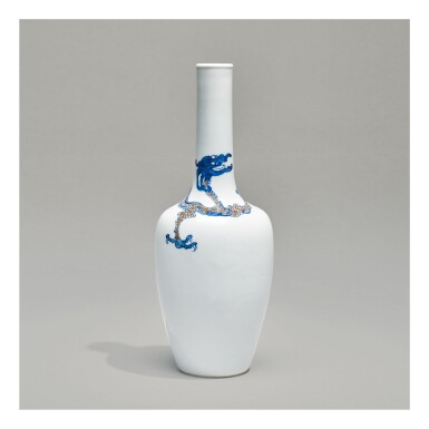 A RARE UNDERGLAZE-BLUE AND COPPER-RED 'DRAGON' BOTTLE VASE,  KANGXI MARK AND PERIOD