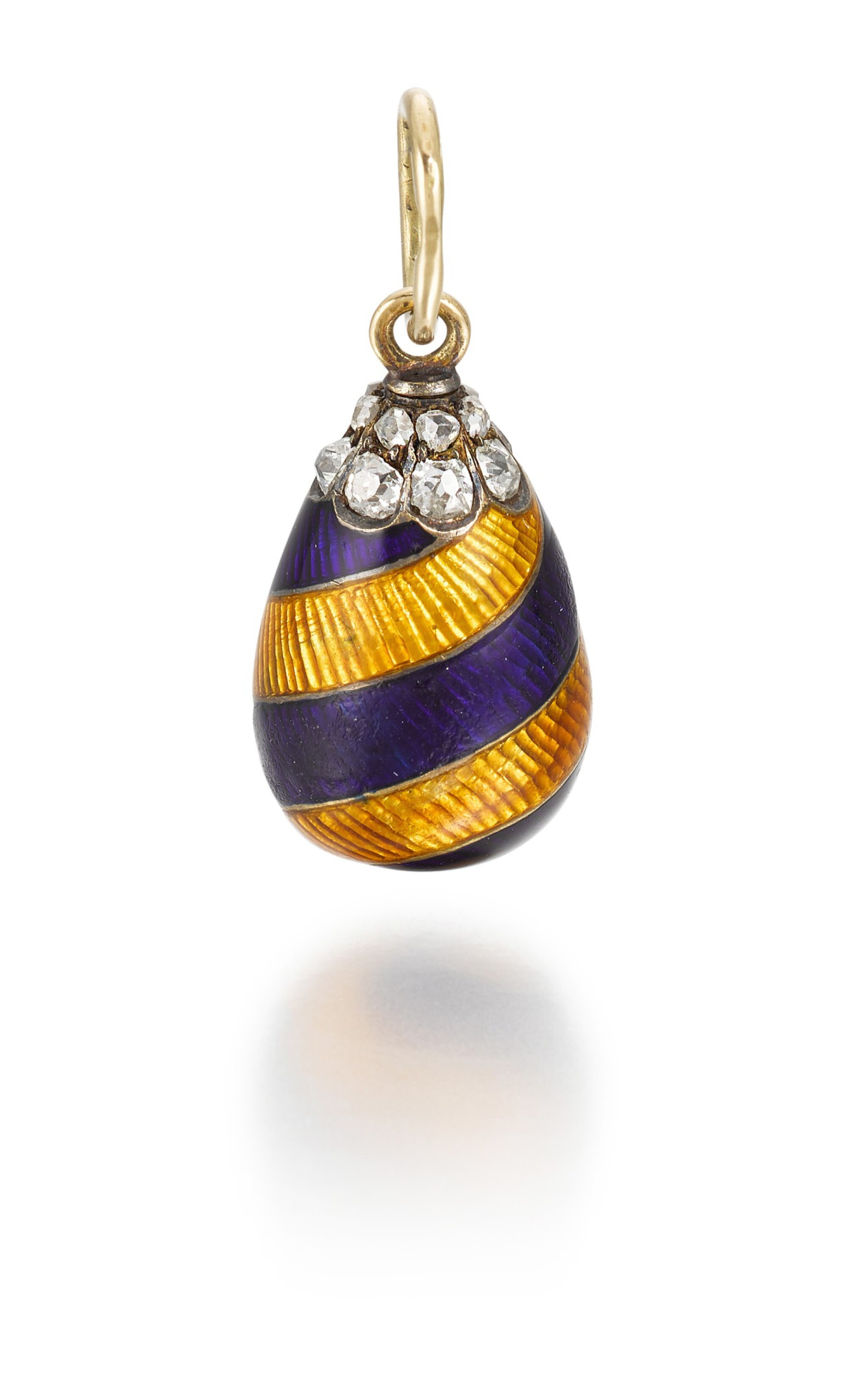 View full screen - View 1 of Lot 7. A Fabergé jewelled gold and guilloché enamel egg pendant in the racing colours of Leopold de Rothschild, workmaster August Hollming, St Petersburg, circa 1910.