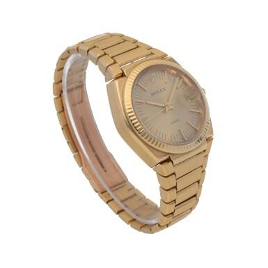 View 3. Thumbnail of Lot 428. 'The Texan' Quartz, Ref. 5100 BETA 21 Yellow gold wristwatch with date and bracelet Circa 1970 | 勞力士 5100 BETA 21型號「'The Texan' Quartz」黃金鍊帶腕錶備日期顯示,年份約1970.