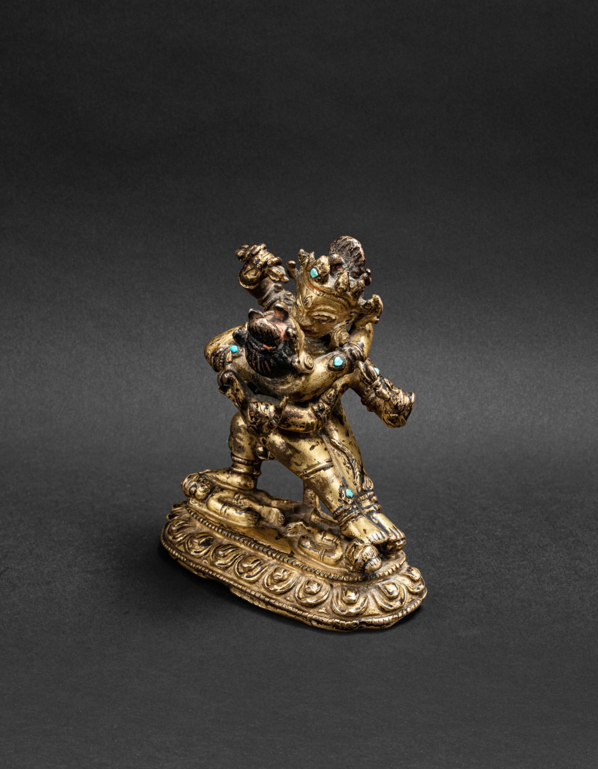 View 1 of Lot 35. Figure de Vajrahumkara en alliage de cuivre Tibet, XIVE siècle | 西藏 十四世紀 鎏金銅合金大威紅勝金剛立像 | A gilt-copper alloy figure of Vajrahumkara, Tibet, 14th century.
