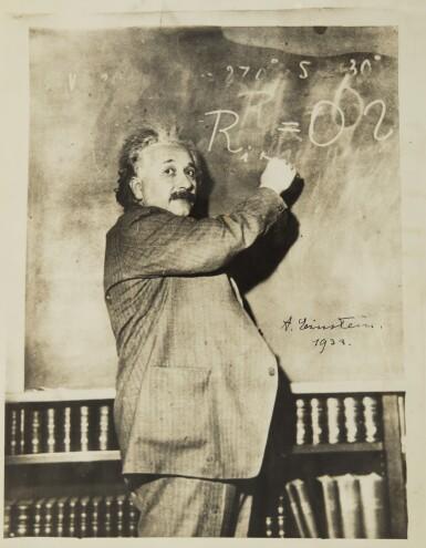 [EINSTEIN, ALBERT] | AN EXCEPTIONAL SIGNED PHOTOGRAPH OF EINSTEIN AT CHALKBOARD, 1931, SIGNED BY EINSTEIN