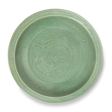 View 1. Thumbnail of Lot 512. A LARGE INCISED 'LONGQUAN' CELADON-GLAZED 'FIVE-CLAWED DRAGON' DISH,  EARLY MING DYNASTY.