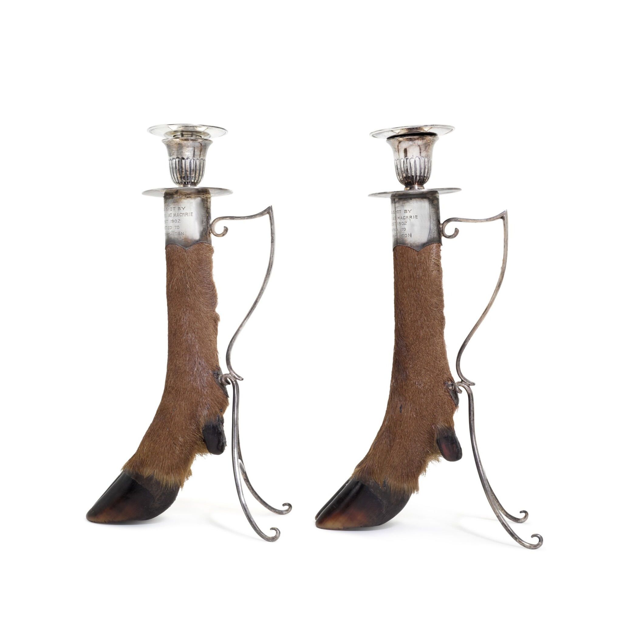 View full screen - View 1 of Lot 43. A pair of Edwardian silver-mounted stag's foot candle holders, Charles Edwards, London, 1901.
