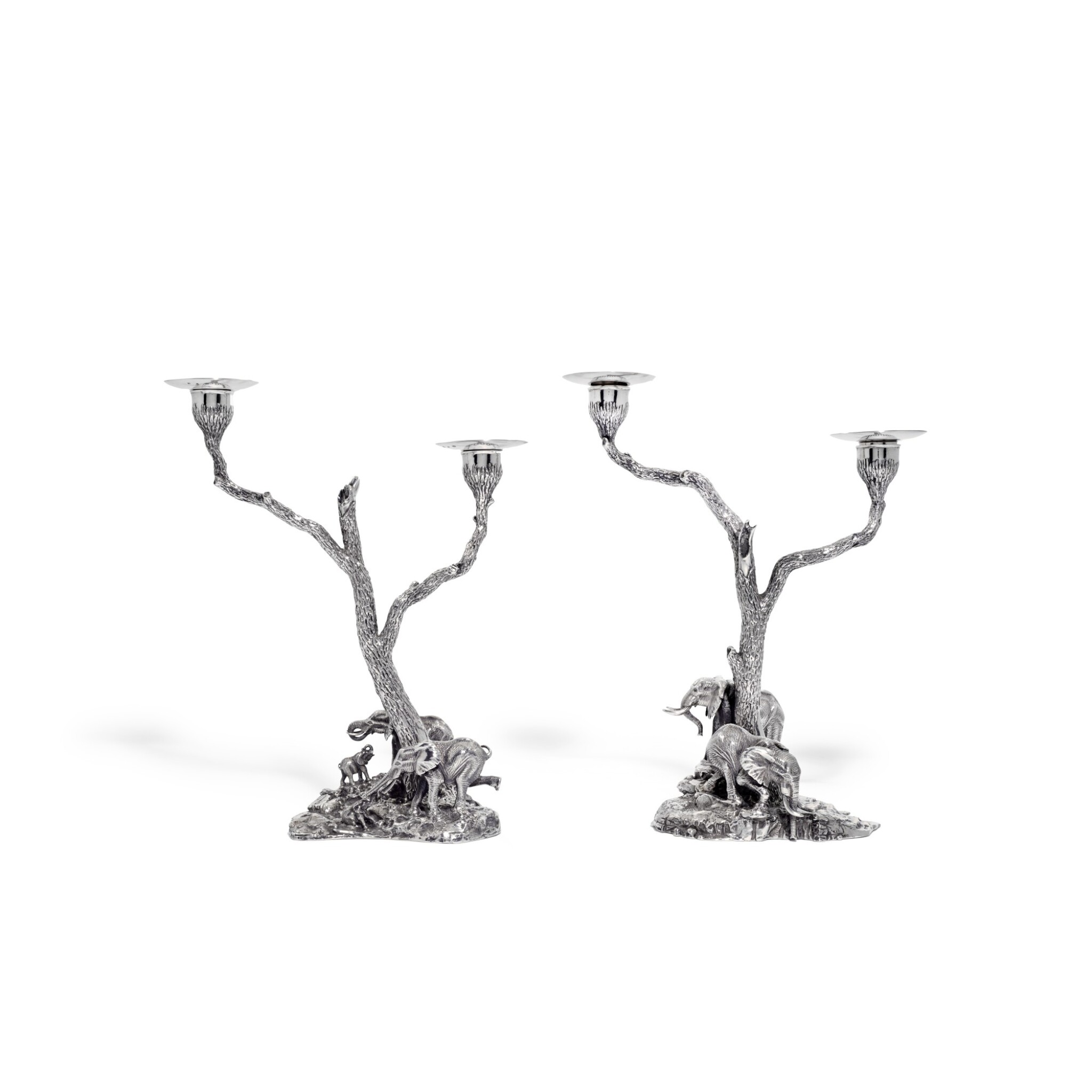 View full screen - View 1 of Lot 102. A pair of silver two-light sculptural candelabra, Patrick Mavros, Zimbabwe, 1999.