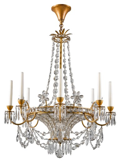 View 1. Thumbnail of Lot 188. AN EMPIRE STYLE GILT-METAL AND CUT GLASS EIGHT-LIGHT CHANDELIER 20TH CENTURY, POSSIBLY BY MAISON BAGUES.