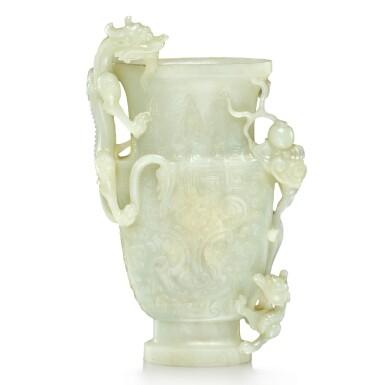 View 1. Thumbnail of Lot 28. An archaistic pale celadon jade 'dragon' vase, Qing dynasty, 19th century   清十九世紀 青白玉雕雙龍戲珠仿古饕餮紋瓶.