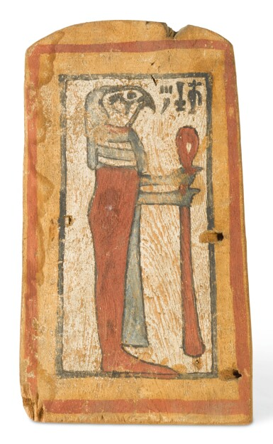 AN EGYPTIAN WOOD PANEL WITH QEBEHSENUEF, LATE PERIOD, 716-30 B.C.