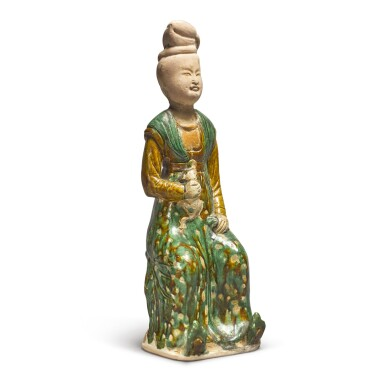 View 3. Thumbnail of Lot 691. A RARE SANCAI-GLAZED POTTERY FIGURE OF A SEATED COURT LADY, TANG DYNASTY.
