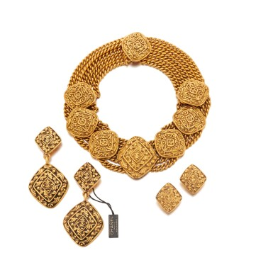 View 1. Thumbnail of Lot 66. Gold-tone metal necklace and two pairs of earrings.