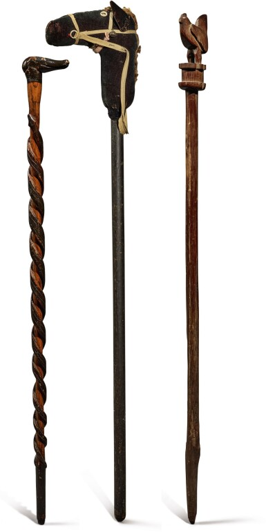 TWO CARVED AND PAINTED WOODEN WALKING STICKS, LATE 19TH AND EARLY 20TH CENTURY