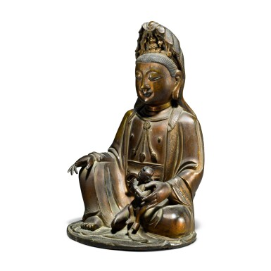 View 3. Thumbnail of Lot 43. A gilt-bronze figure of Guanyin and child, Ming / early Qing dynasty.