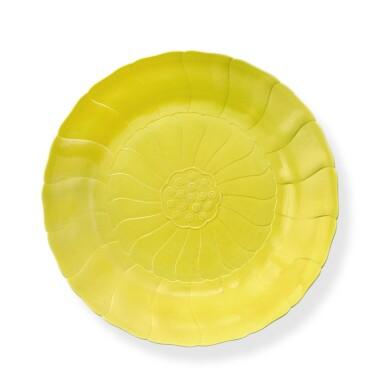 View 1. Thumbnail of Lot 73. A rare molded lemon-yellow-enameled 'lotus' dish, Mark and period of Yongzheng   清雍正 檸檬黃釉蓮花式盤 《大清雍正年製》款.