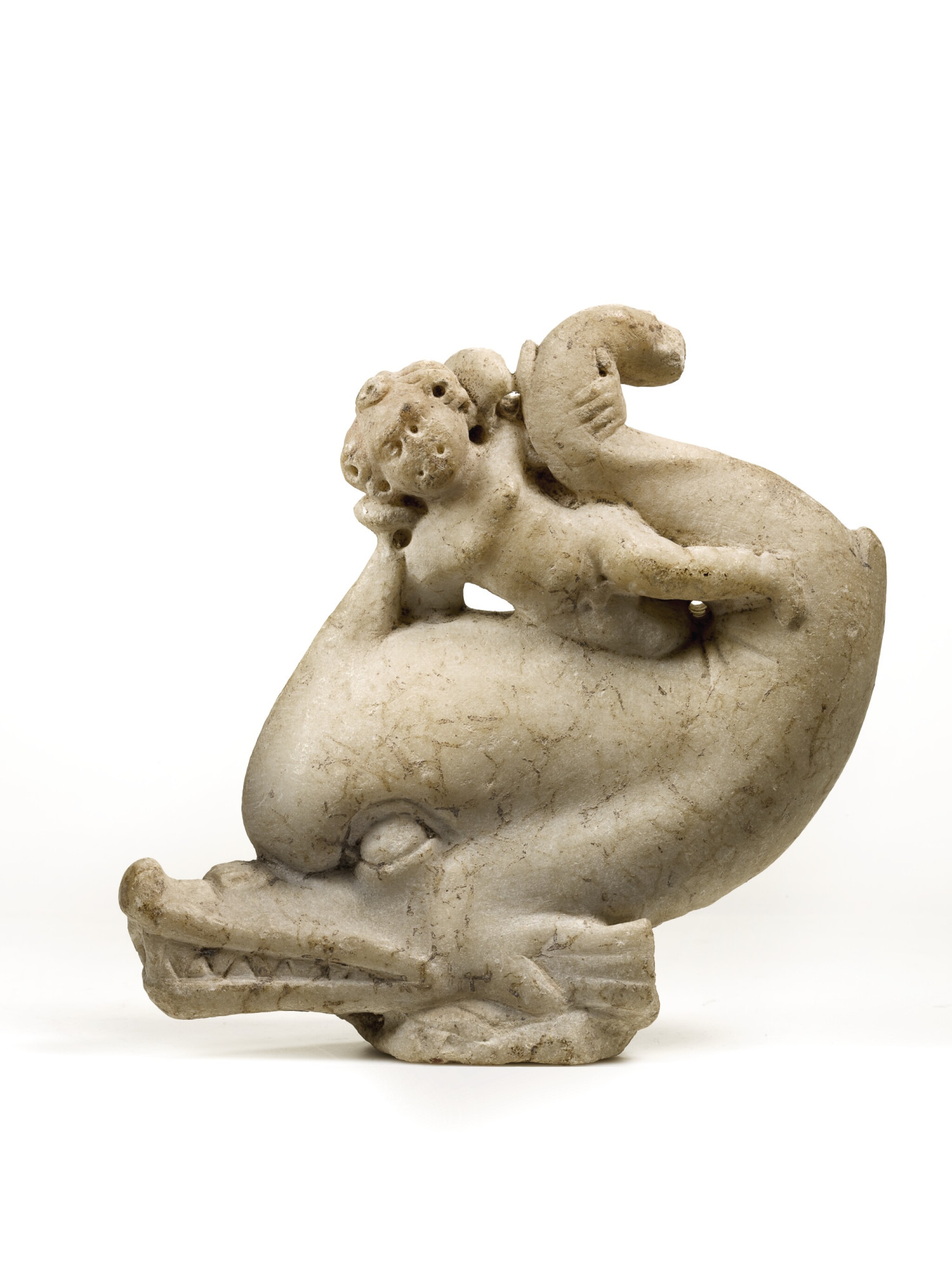 View full screen - View 1 of Lot 13. A ROMAN MARBLE GROUP OF EROS ON A DOLPHIN, CIRCA 2ND CENTURY A.D..