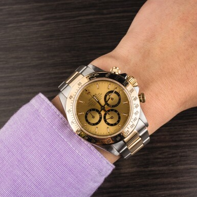 ROLEX   Daytona, Ref. 16523, A Stainless Steel and Yellow Gold Chronograph Wristwatch with Bracelet, Circa 1995