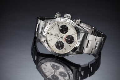 View 5. Thumbnail of Lot 217. Reference 6265 'Big Red' Daytona Retailed by Tiffany & Co.: A stainless steel chronograph wristwatch with bracelet, Circa 1979.