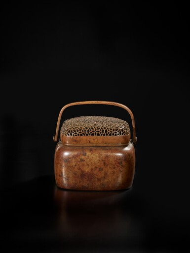 View 1. Thumbnail of Lot 126. A bronze hand warmer and cover, signed Zhang Mingqi, 17th century | 十七世紀 銅透空錦紋蓋手爐 《張鳴岐製》款.