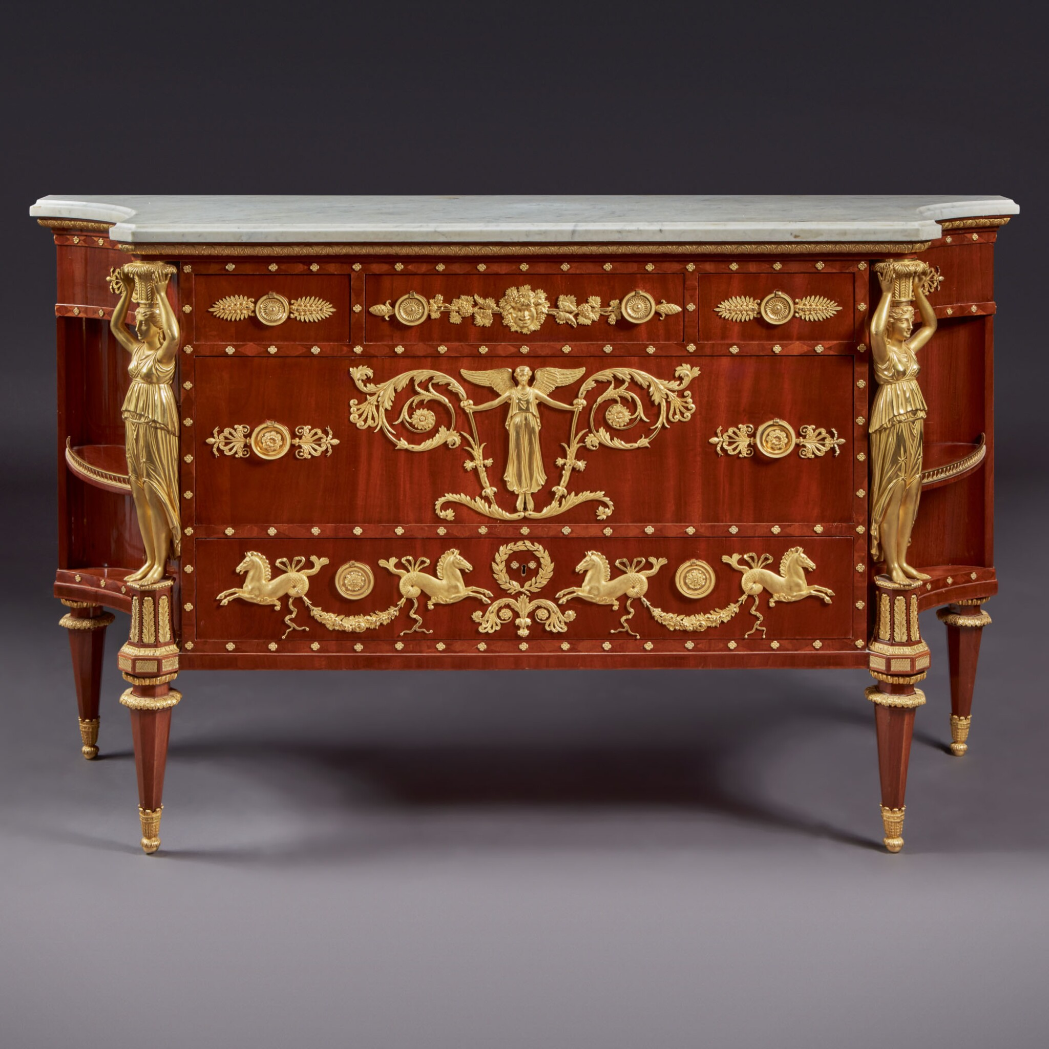 View full screen - View 1 of Lot 127. A LATE LOUIS XVI GILT BRONZE-MOUNTED MAHOGANY COMMODE, AFTER A DESIGN BY PERCIER AND FONTAINE, CIRCA 1790-95.