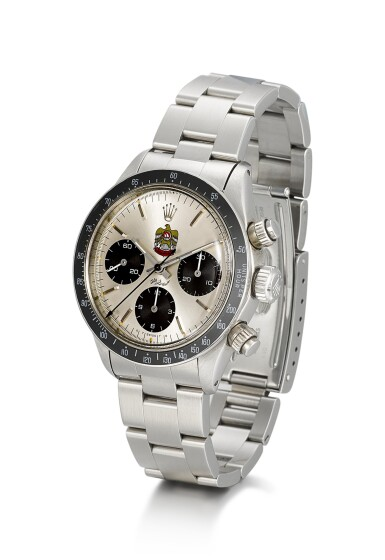 View 2. Thumbnail of Lot 5. ROLEX | DAYTONA, REFERENCE 6263, A STAINLESS STEEL CHRONOGRAPH WRISTWATCH WITH UAE QURAYSH HAWK DIAL, MADE FOR MOHAMMED BIN RASHID AL MAKTOUM, CIRCA 1975.