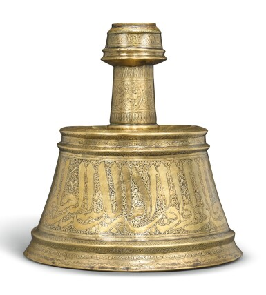 A LARGE MAMLUK BRASS CANDLESTICK MADE FOR AN OFFICER, SYRIA OR EGYPT, EARLY 14TH CENTURY