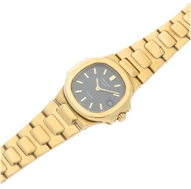 View 6. Thumbnail of Lot 34. REFERENCE 4700/1 NAUTILUS RETAILED BY TIFFANY & CO.: A LADY'S YELLOW GOLD BRACELET WATCH WITH DATE, CIRCA 1985.