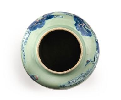 View 5. Thumbnail of Lot 143. An underglaze-blue, copper-red, and celadon-glazed jar, Qing dynasty, Kangxi period   清康熙 豆青地青花釉裏紅松下高士圖罐.