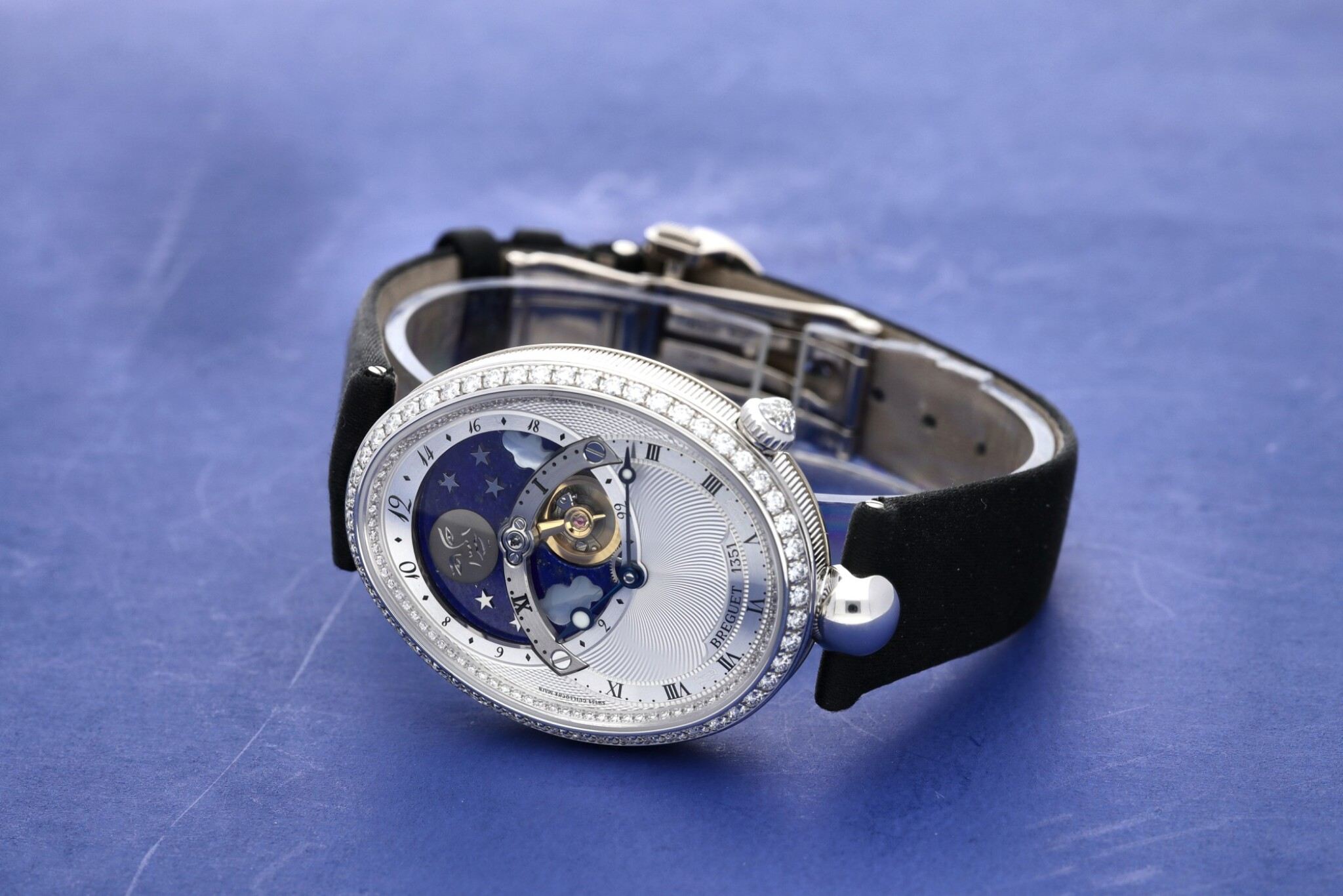 View full screen - View 1 of Lot 107. Reference 8998 Reine De Naples A white gold and diamond-set automatic oval wristwatch with moon phases and 24-hour indication, Circa 2015.