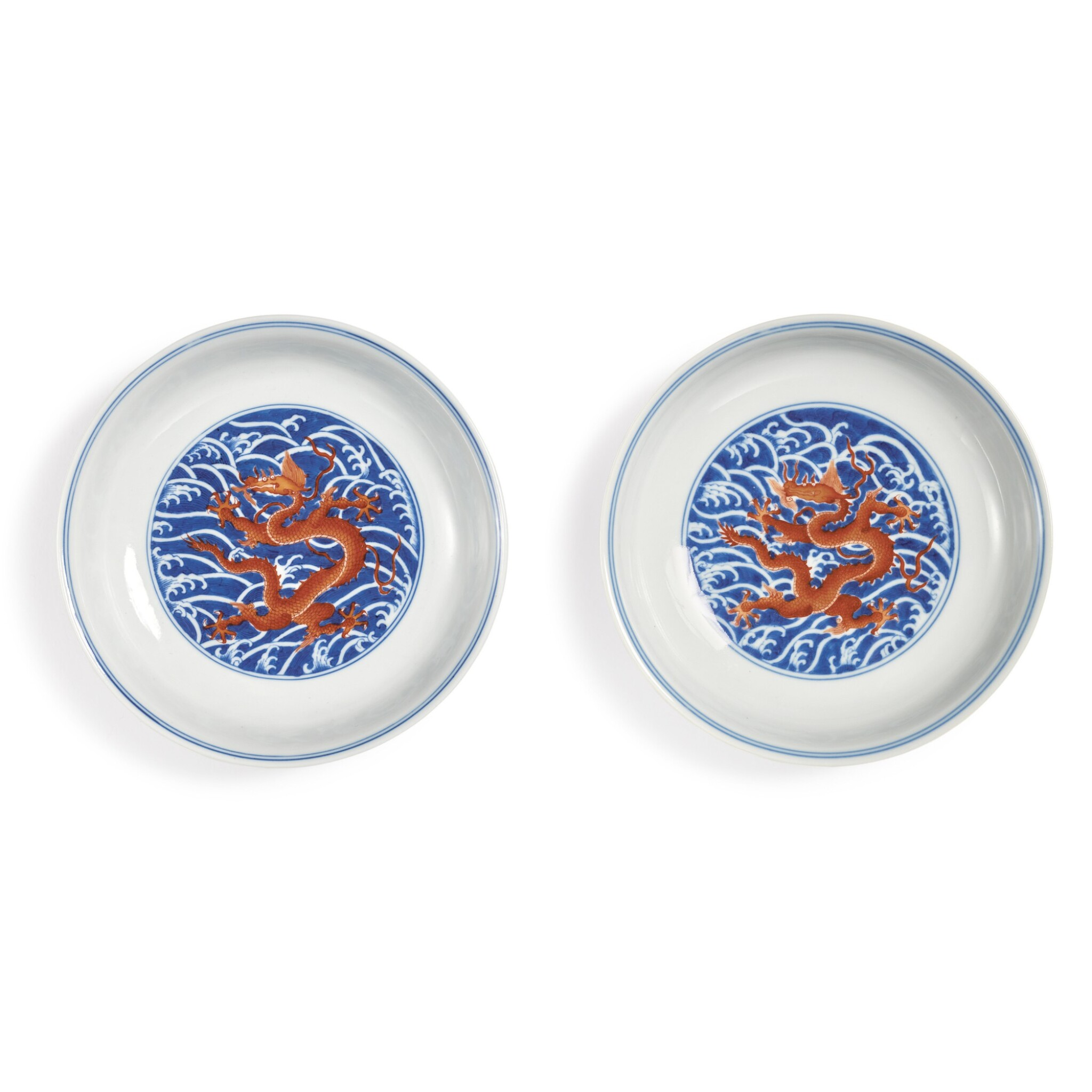 View full screen - View 1 of Lot 545. A PAIR OF FINE IRON-RED AND UNDERGLAZE-BLUE 'DRAGON' DISHES,  QIANLONG SEAL MARKS AND PERIOD.