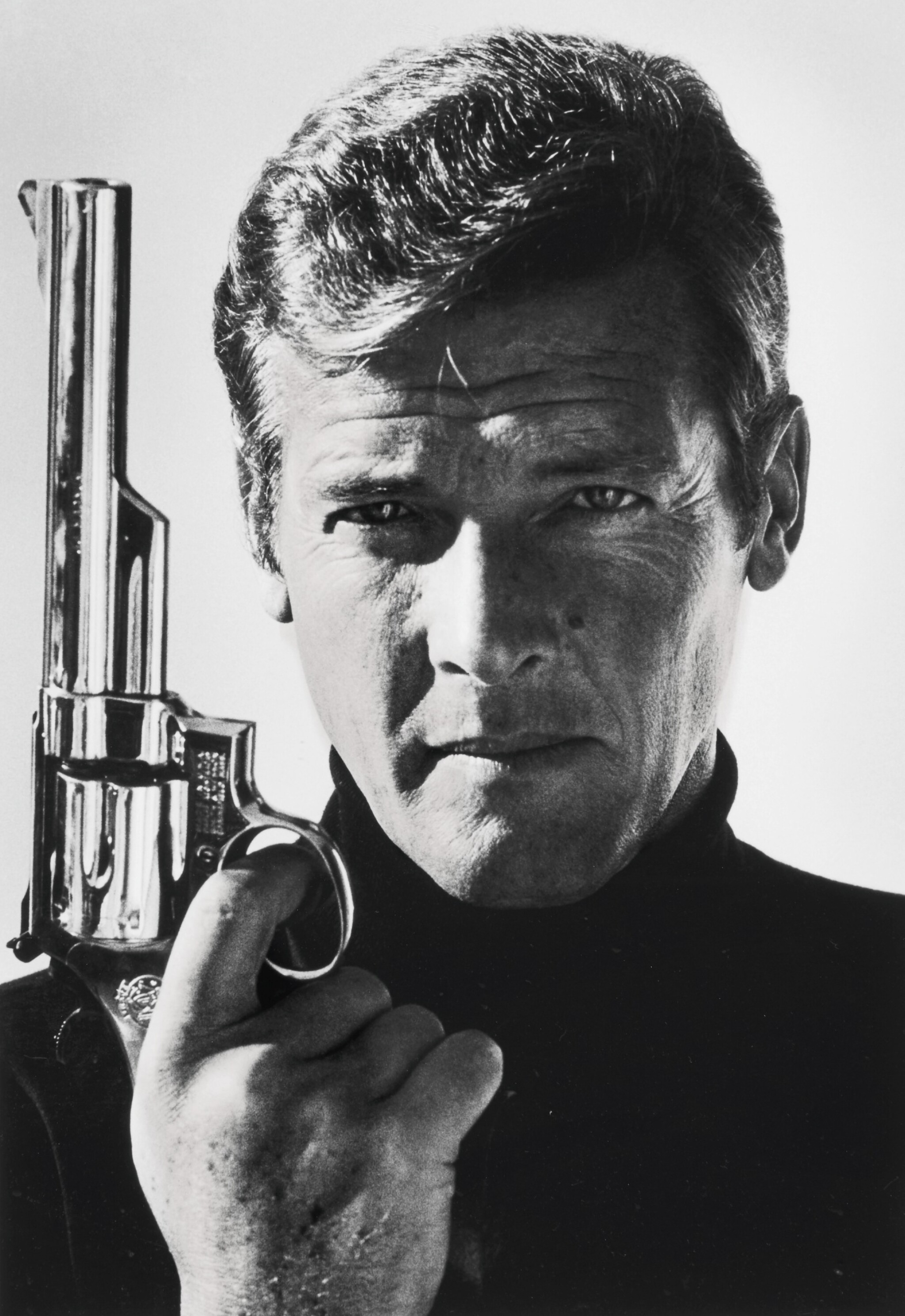View full screen - View 1 of Lot 240. TERRY O'NEILL | SIR ROGER MOORE AS JAMES BOND, 1973.