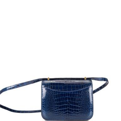 View 4. Thumbnail of Lot 3. Hermès Bleu Saphir Constance 18cm of Shiny Alligator with Gold Hardware.