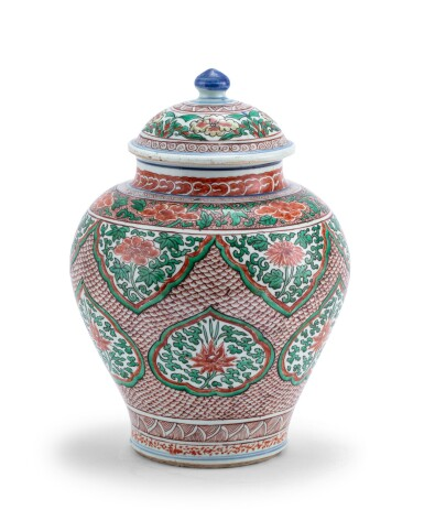 View 1. Thumbnail of Lot 155. Vase couvert en porcelaine wucai XVIIE siècle | 十七世紀 五彩開光花卉紋將軍罐 | A wucai jar and cover, 17th century .