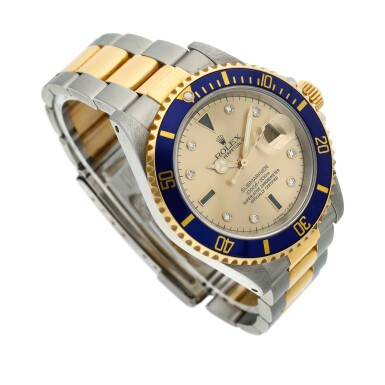 View 2. Thumbnail of Lot 9. Reference 16613 Submariner  A yellow gold and stainless steel wristwatch with date, bracelet and diamond and sapphire-set indexes, Circa 1990 .