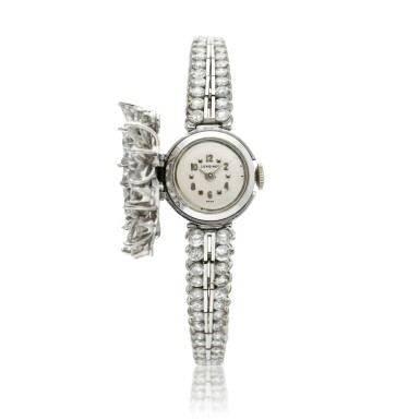 View 2. Thumbnail of Lot 96. A lady's platinum diamond set cocktail wristwatch on diamond link bracelet, Circa 1960.