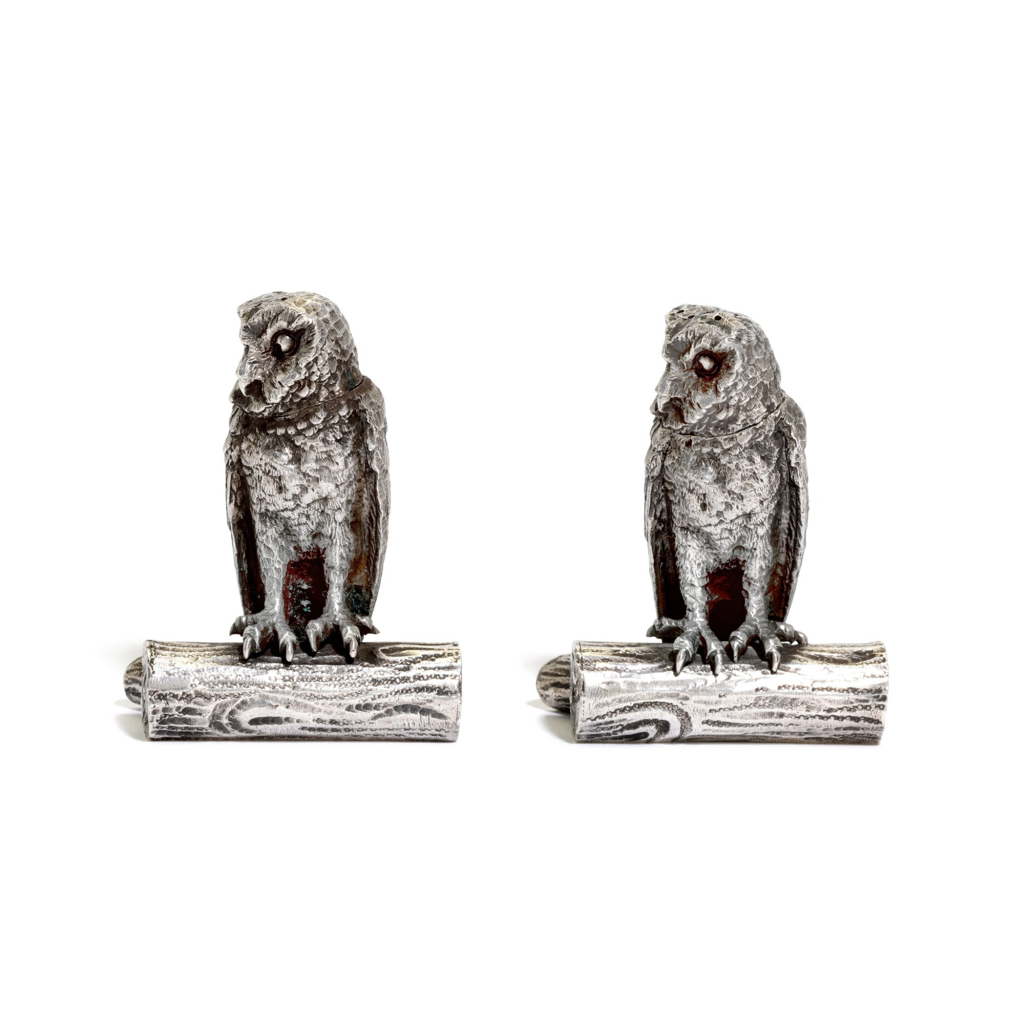 View full screen - View 1 of Lot 33. A pair of Victorian silver owl pepperettes , George Heath & Co., London, 1891.