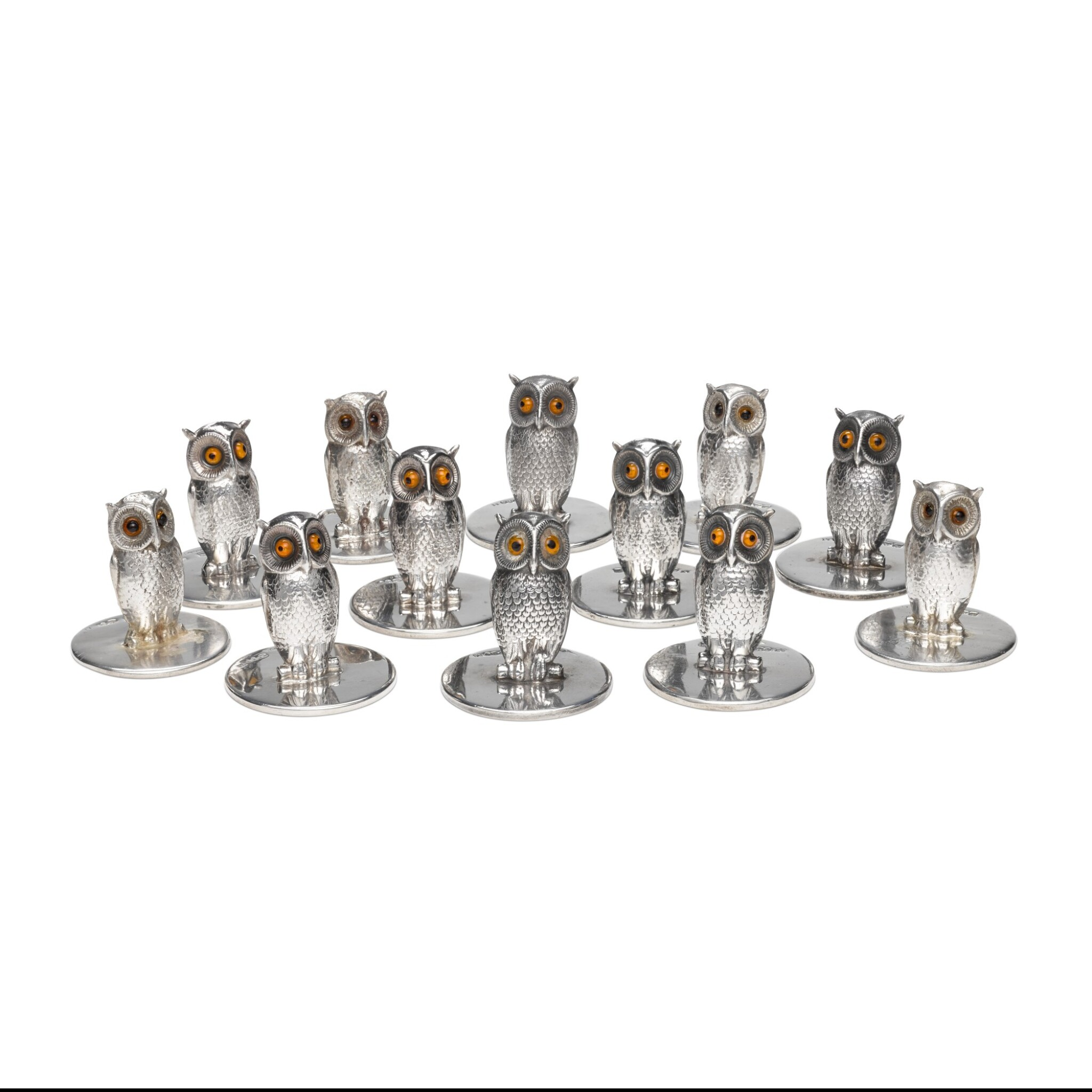 View full screen - View 1 of Lot 34. A set of twelve silver and glass owl menu holders, S. Mordan & Co., Chester, 1905-1912.