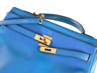 View 3. Thumbnail of Lot 16. KELLY 32 RETOURNE BLUE FRANCE COLOUR IN COURCHEVEL LEATHER WITH GOLD HARDWARE. HERMÈS, 1992 .