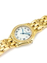 CARTIER | COUGAR, A YELLOW GOLD AND DIAMOND SET CENTER SECONDS WRISTWATCH WITH DATE AND BRACELET CIRCA 2000
