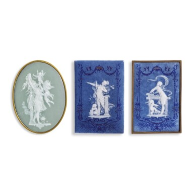 A PAIR OF FRENCH PÂTE-SUR-PÂTE BLUE-GROUND RECTANGULAR PLAQUES AND AN OVAL GREEN-GROUND PLAQUE, 'LA TOILETTE', BY TAXILE DOAT  DATED 1881 AND 1883