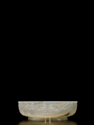 View 3. Thumbnail of Lot 62. An extremely rare inscribed archaistic celadon jade 'twin fish' basin, Mark and period of Qianlong | 清乾隆 青玉雕雙魚盤 《大清乾隆倣古》款.