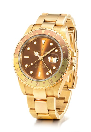 View 2. Thumbnail of Lot 101. ROLEX | GMT-MASTER II, REFERENCE 16718, A YELLOW GOLD WRISTWATCH WITH DATE AND BRACELET, CIRCA 1993.