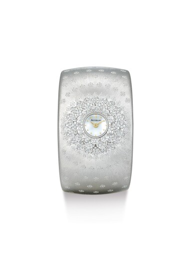 BUCELLATI | ANTHOCHRON, A WHITE GOLD AND DIAMOND-SET BANGLE WATCH WITH MOTHER OF PEARL DIAL, CIRCA 1995
