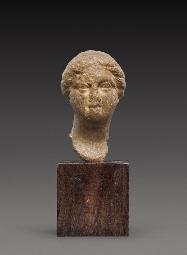 View 1. Thumbnail of Lot 101. A Hellenistic Marble Head of a Woman or Goddess, 2nd/1st Century B.C..