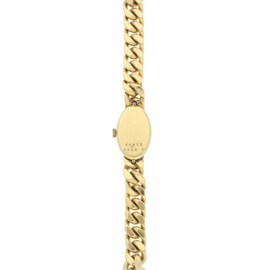 View 5. Thumbnail of Lot 221. REFERENCE 5026/1 A LADY'S YELLOW GOLD BRACELET WATCH WITH TIGER EYE DIAL, CIRCA 1990'S.