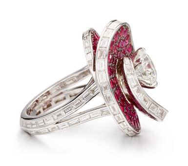 View 3. Thumbnail of Lot 1028. 'Double Swirl' Diamond and Ruby Ring | 格拉夫| 'Double Swirl' 2.08克拉 圓形 G色 鑽石 配 紅寶石 戒指 (鑽石及紅寶石共重約3.60及5.70克拉).