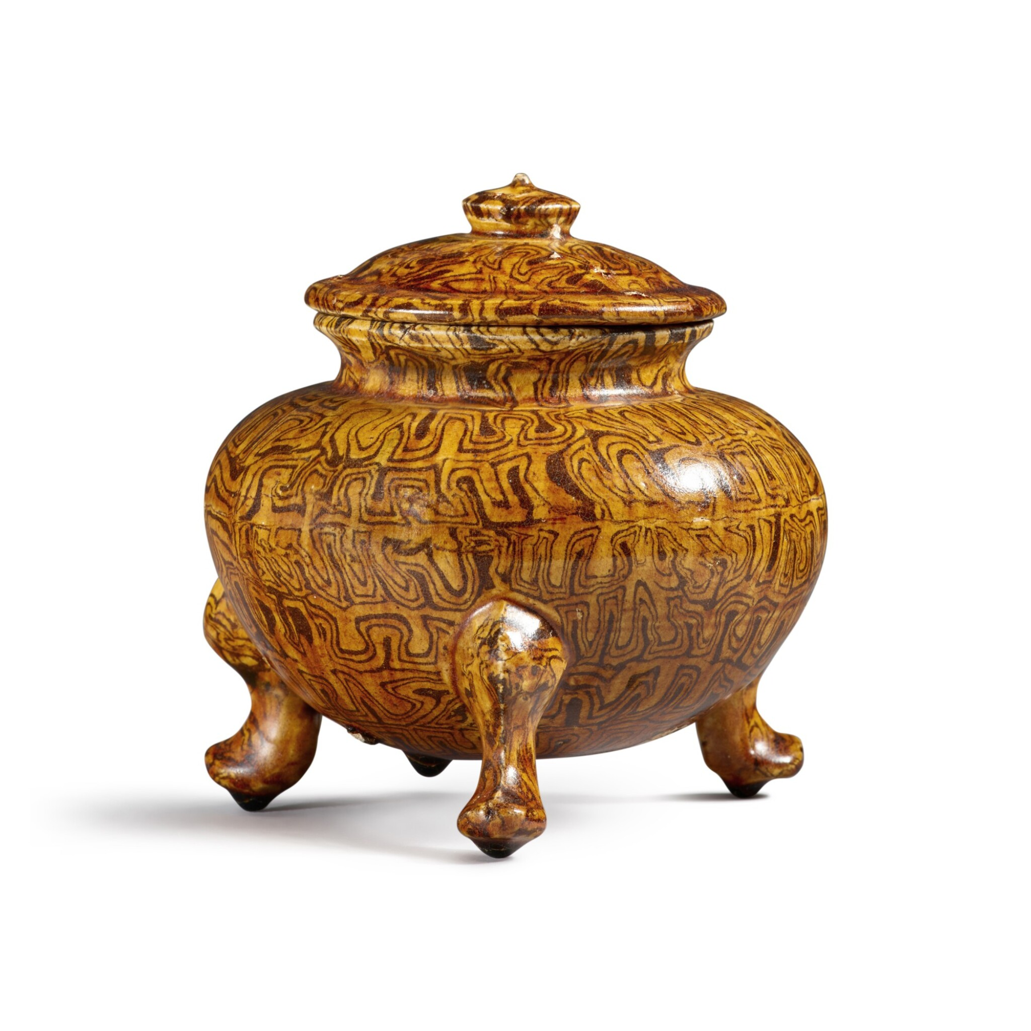 View full screen - View 1 of Lot 175. A rare amber-glazed marbled pottery tripod jar and cover, Tang dynasty | 唐 琥珀釉絞胎三足蓋爐.