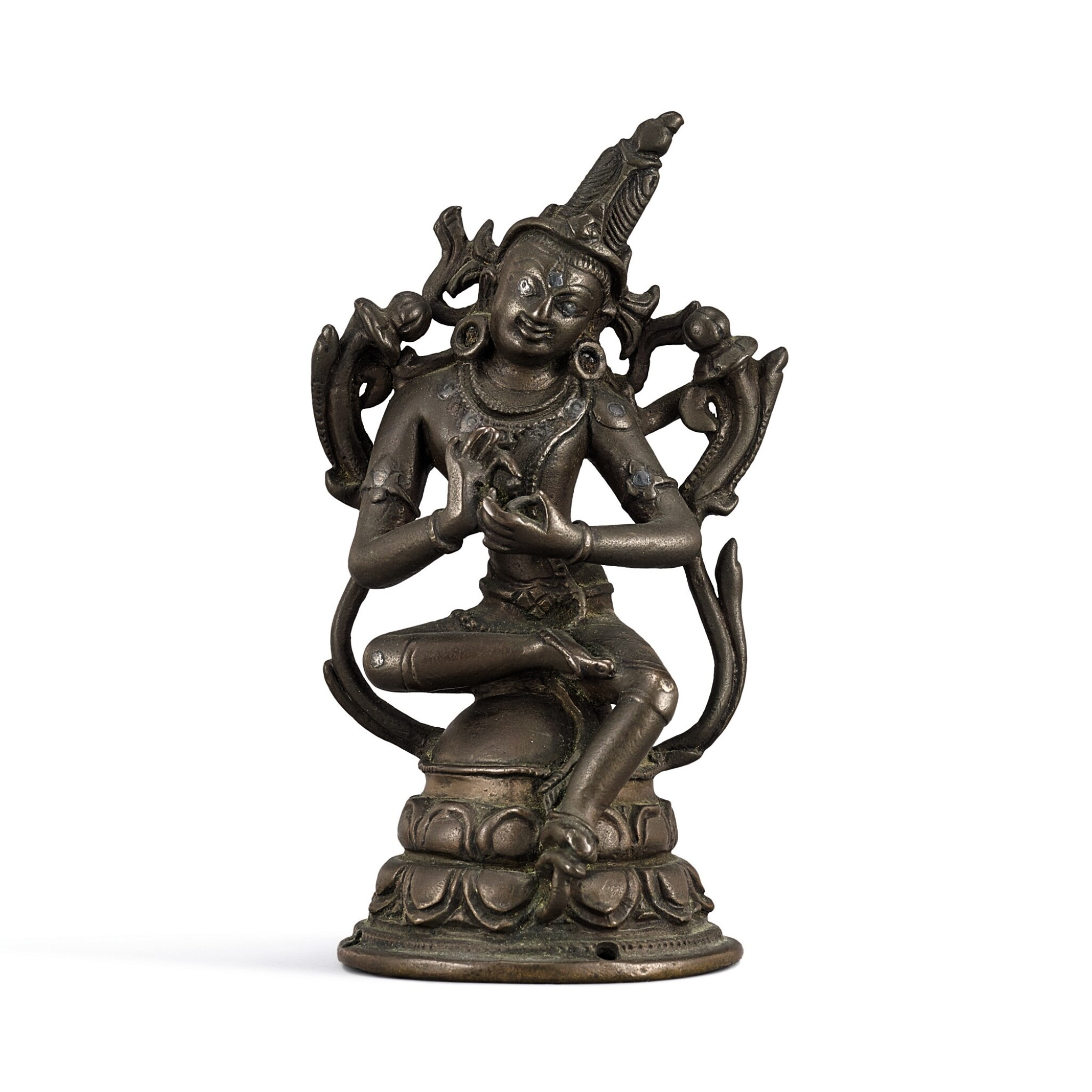 View full screen - View 1 of Lot 113. A silver-inlaid copper alloy figure of Avalokiteshvara Pala, Eastern India, 12th century   十二世紀 帕拉東印度銅錯銀觀世音菩薩坐像.