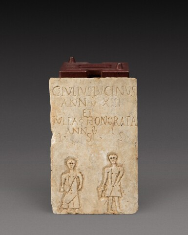 View 1. Thumbnail of Lot 105. A Roman Marble Funerary Plaque inscribed for Gaius and Julia, probably Gallo-Roman, circa 2nd/3rd Century A.D..
