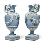 A PAIR OF WEDGWOOD BLUE AND WHITE JASPERWARE 'WATER' AND 'WINE' EWERS CIRCA 1785-90